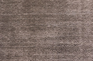 Close up of brown synthetic carpet