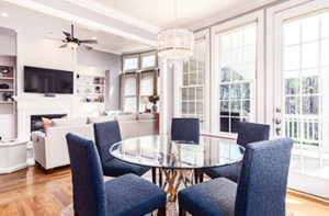 kitchen-with-small-table-blue-chairs-and-hardwood-floors