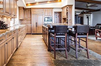 carpet-in-kitchen-with-hardwood-floor