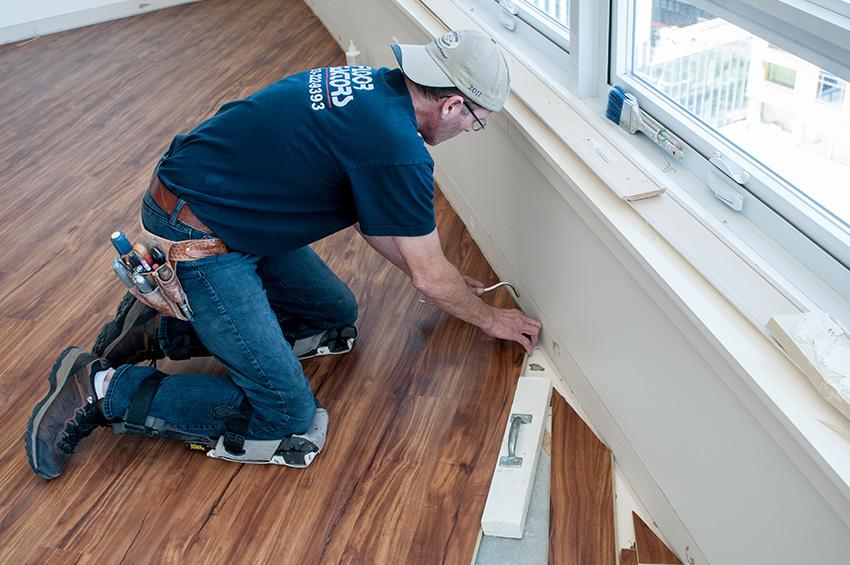 man-installing-flooring