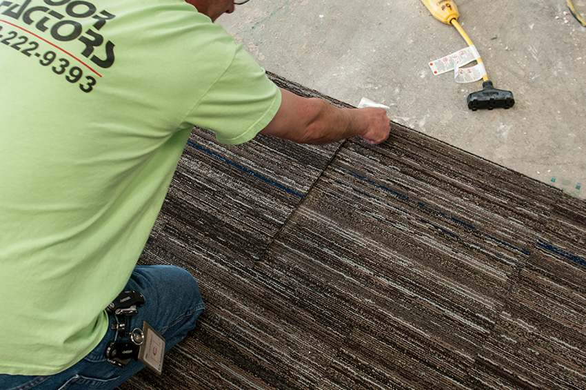 man-installing-carpet-over-concrete