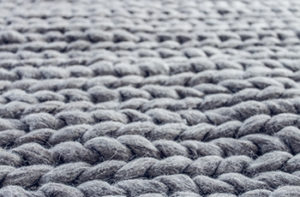 grey-area-rug-with-braided-pattern
