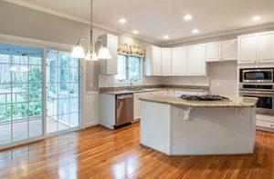 shiny-hardwood-floors-in-white-kitchen