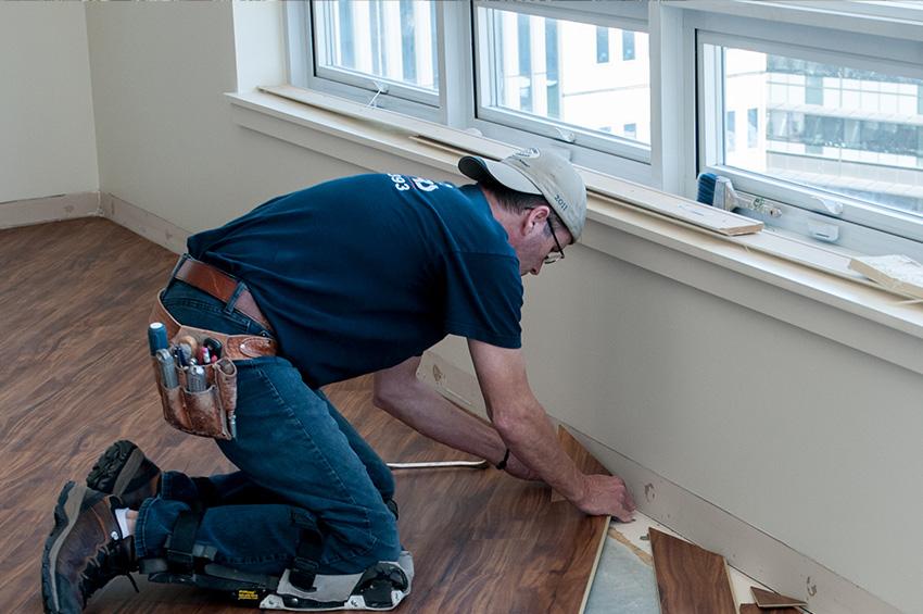 man-installing-hardwood-floors