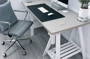 desk-and-chair-on-gray-hardwood-floor