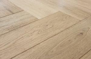 wood-floor-with-a-herringbone-pattern