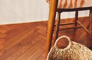 herringbone-hardwood-floors-with-basket-chair
