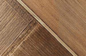 Close up of textured luxury vinyl tiles that look like wood.