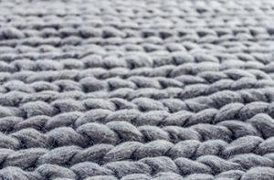 Closeup of a wool area rug.
