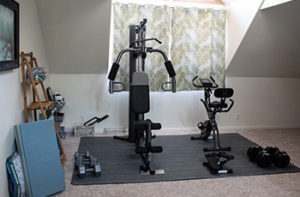 A howe gym showcases modern exercise equipment which is placed on a floor covered in carpet tiles