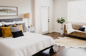 Rich mahogany wood-like looking laminate flooring in a guest bedroom