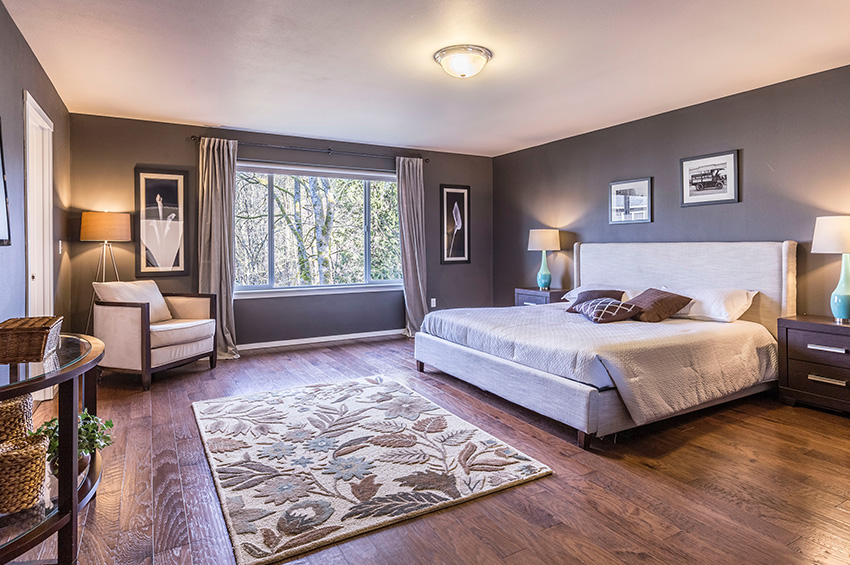 Dark wood-like laminate flooring in a master bedroom